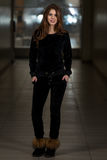 Beautiful Woman Wearing Fashion Tracksuit In Black Stock Photo