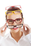 Beautiful woman wearing four different pairs of eyeglasses. Royalty Free Stock Image