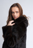 Beautiful woman wearing fur coat Stock Images