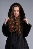 Beautiful woman wearing fur coat Royalty Free Stock Images