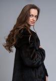 Beautiful woman wearing fur coat Stock Photos