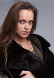 Beautiful woman wearing fur coat Stock Photography