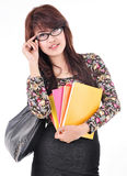 Beautiful woman wearing glasses, holding a book and carry bag Royalty Free Stock Image