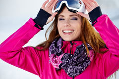 Beautiful woman wearing goggles in snowy winter Royalty Free Stock Images