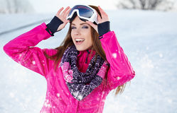 Beautiful woman wearing goggles in snowy winter Royalty Free Stock Photos