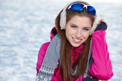 Beautiful woman wearing goggles in snowy winter Royalty Free Stock Image