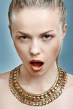 Beautiful woman wearing golden jewelry. Royalty Free Stock Photo
