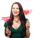 Beautiful woman wearing green dress holding paper hearts Royalty Free Stock Photos