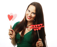Beautiful woman wearing green dress holding paper hearts Stock Images
