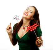 Beautiful woman wearing green dress holding paper hearts Royalty Free Stock Images