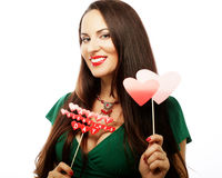Beautiful woman wearing green dress holding paper hearts Royalty Free Stock Photography