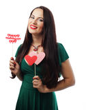 Beautiful woman wearing green dress holding paper hearts Royalty Free Stock Photo