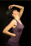 Beautiful woman wearing hat and dancing Royalty Free Stock Images