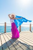 Beautiful woman wearing hat and pink skirt Stock Photography