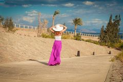 Beautiful woman wearing hat and pink skirt Royalty Free Stock Images