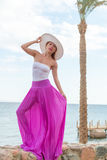 Beautiful woman wearing hat and pink skirt Royalty Free Stock Photography