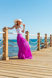 Beautiful woman wearing hat and pink skirt Royalty Free Stock Image