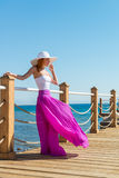 Beautiful woman wearing hat and pink skirt Stock Image