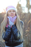 Beautiful woman wearing hat, scarf and down jacket in cold weath Royalty Free Stock Photos