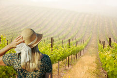 Beautiful Woman Wearing a Hat Strolling at a Winery Royalty Free Stock Photos