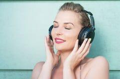 Beautiful woman wearing headphones and enjoying music Royalty Free Stock Photo