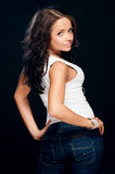 Beautiful woman wearing jeans and singlet Stock Photo