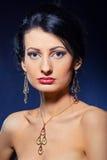 Beautiful woman wearing jewelry. Portrait of elegant beautiful woman wearing jewelry stock photo