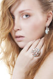 Beautiful woman wearing jewelry. Portrait of elegant beautiful woman wearing jewelry royalty free stock photos