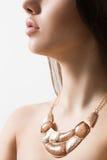 Beautiful woman wearing jewelry. On a light background royalty free stock image