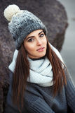 Beautiful woman wearing knitted winter clothes outdoors. stock image
