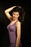 Beautiful woman wearing lilac dress and dancing Royalty Free Stock Photo