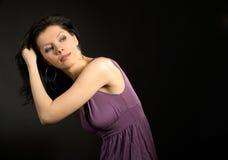 Beautiful woman wearing lilac dress and dancing Royalty Free Stock Photos