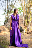 Beautiful woman wearing a long purple dress Royalty Free Stock Photo