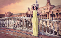 Beautiful woman wearing long yellow dress Royalty Free Stock Photo