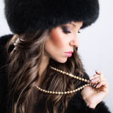 Beautiful woman wearing luxury fur coat and hat Royalty Free Stock Photo
