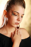 Beautiful woman wearing make-up Stock Photos