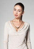 Beautiful woman wearing necklace on grey background Stock Images