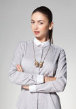 Beautiful woman wearing necklace on grey background Stock Image