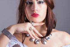 Beautiful woman wearing necklace and rings Royalty Free Stock Image