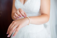 Beautiful woman wearing pearl bracelet on her hand Stock Photos