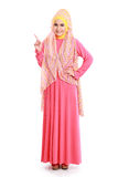 Beautiful woman wearing pink muslim dress pointing Stock Photo