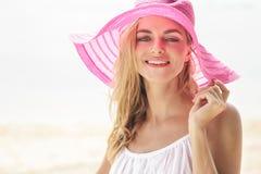 Beautiful woman wearing pink sunhat Royalty Free Stock Photography
