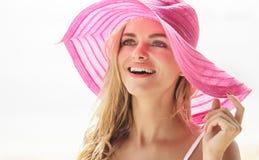 Beautiful woman wearing pink sunhat Stock Image