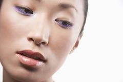 Beautiful Woman Wearing Purple Eye Shadow Royalty Free Stock Photos
