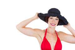 Beautiful woman wearing red bikini and black hat Stock Images