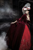 Beautiful Woman Wearing Red Dress Over A Train Royalty Free Stock Images