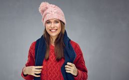 Beautiful woman wearing red knitted sweater. Portrait isolated on gray wall back Stock Photography