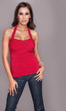 Beautiful woman wearing red top and jeans Stock Photo