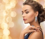 Beautiful woman wearing ring and earrings Stock Images