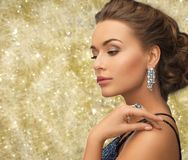 Beautiful woman wearing ring and earrings Stock Photos